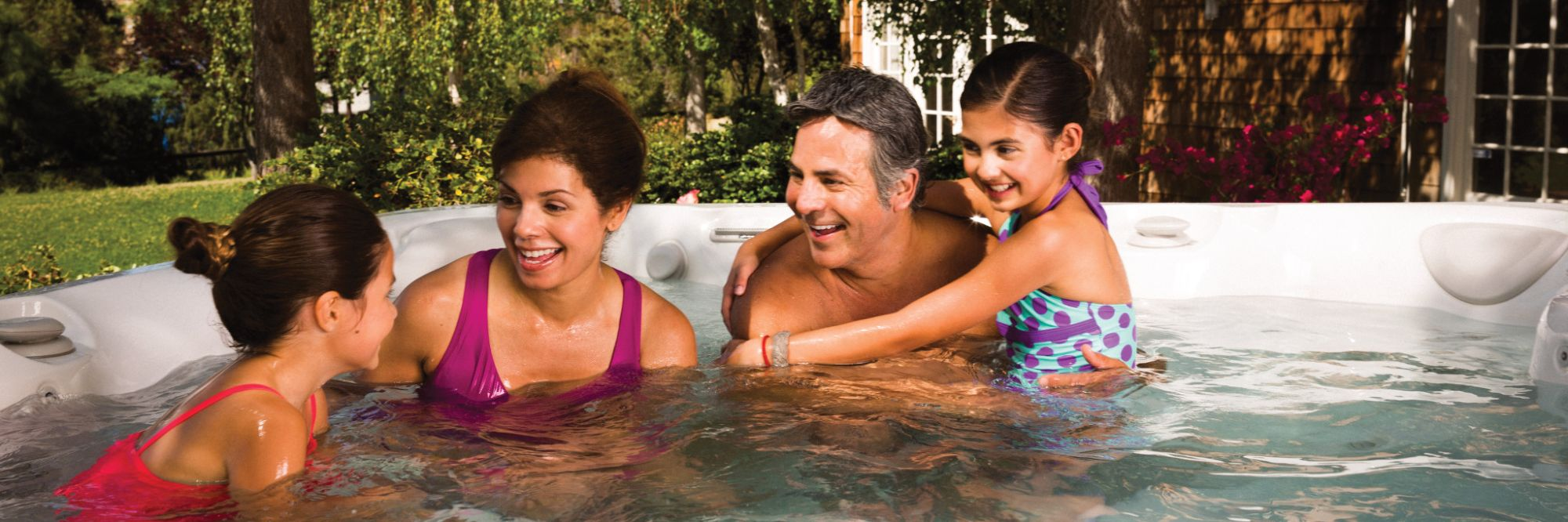 Family Enjoying Hot Tub from Landi Pools and Games